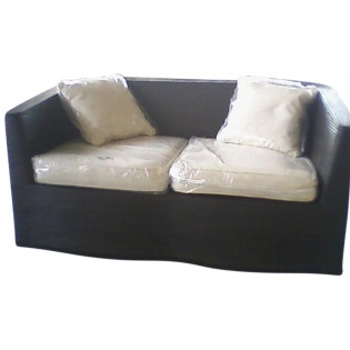 rattan sofa with pillows